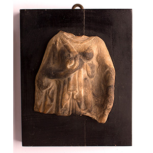 Slab with female figure in ...