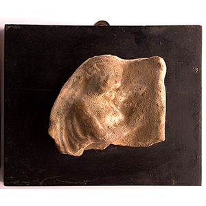 Slab with female figure profile in ...
