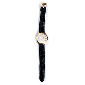 An 18K gold Wristwatch , by ...