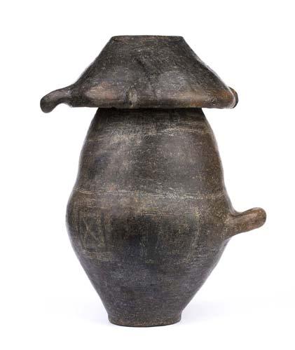 Villanovan cinerary urn with lid ...