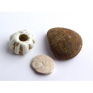Three pendants (one amber) 7th - 6th century ...