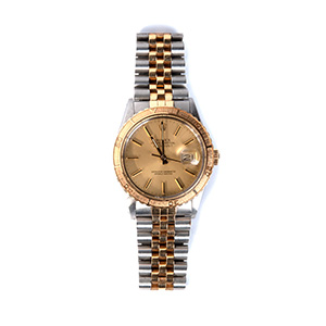 An 18K gold/ Stainless steel Wristwatch, by ...