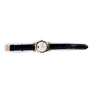 An 18K gold perpetual calendar cronograph ...