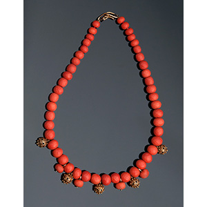 18K gold and coral necklace; ; with one ...