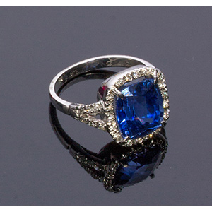 9K GOLD DIAMOND AND SYNTHETIC SAPPHIRE RING; ...