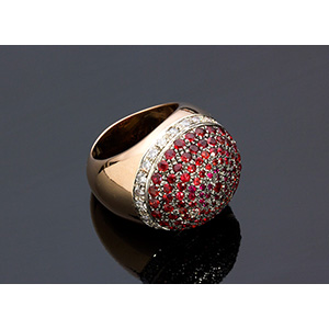 18K GOLD DIAMOND AND GARNET RING; ; a bombed ...