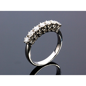 18K GOLD DIAMOND RING; ; centered by a line ...