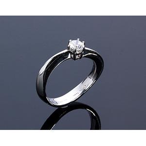 18K GOLD SOLITARY DIAMOND RING; ; centered ...