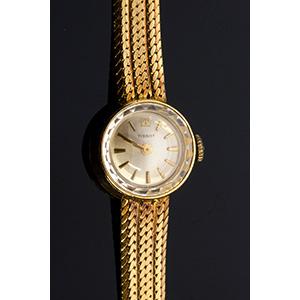 An 18K yellow gold Wristwatch, by TISSOT, ...