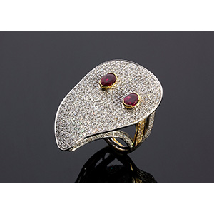 18K GOLD RUBY DIAMOND RING; ; a couple of ...