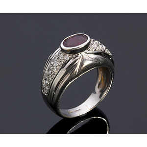 18K GOLD RUBY AND DIAMOND RING; ; a band ...