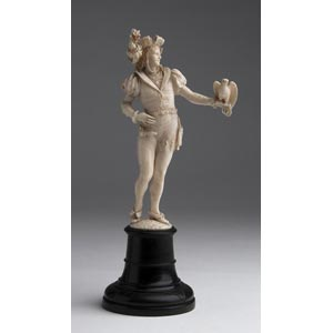 A carved ivory figure of a falconer - W. ...