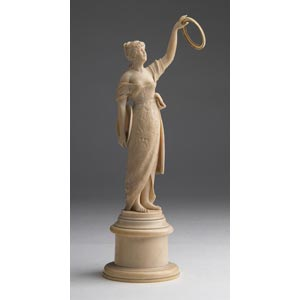 A carved ivory figure of a young lady - ...