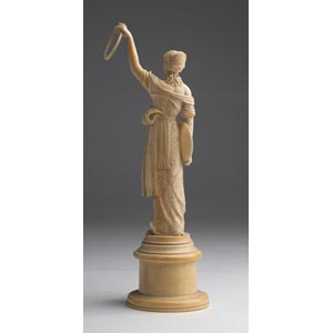 A carved ivory figure of a young ...