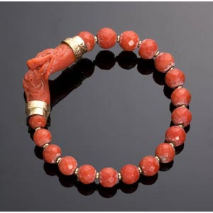 A red coral bangle bracelet with 18 faceted ...