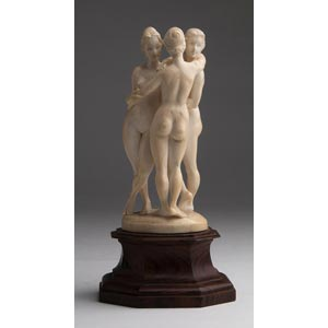 The three Graces. A carved ivory figure ...