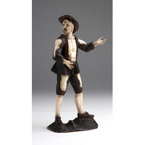 A carved ivory and lime wood figure of a ...