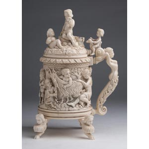 An ivory tankard finely carved with ...