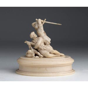 A carved ivory figural group depicting fight ...