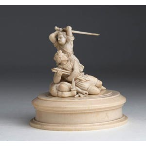 A carved ivory figural group ...