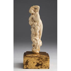 A carved ivory nude female figure - France, ...