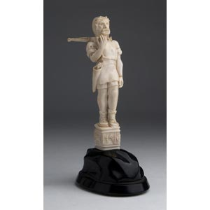 A carved ivory figure of a crossbowman - ...