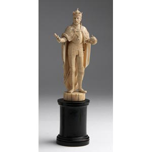 A carved ivory figure of an emperor with the ...