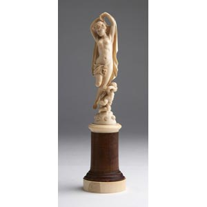 A carved ivory allegorical female figure - ...