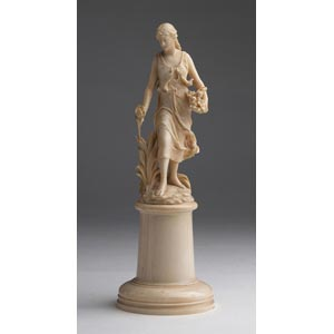 A carved ivory figure of a maiden - France, ...