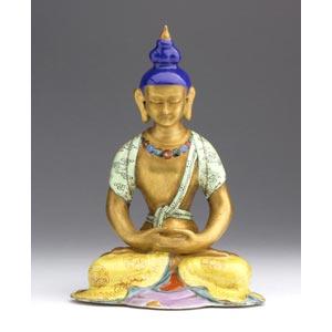 An enamelled porcelain figure of ...