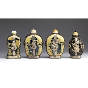 Four porcelain and metal snuff bottles;XX ...