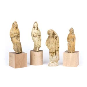 A collection of Tanagra style female figures ...