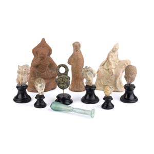 A collection of terracotta bronze and glass ...