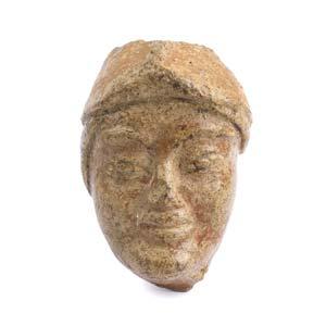 Etruscan helmeted head antefix6th century ...