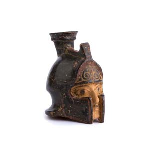 Rhodian aryballos in the shape of a helmeted ...