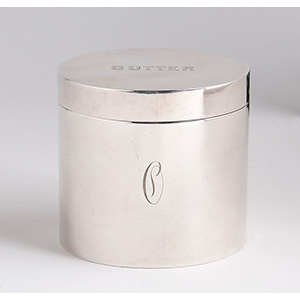 a small silver plated cylindrical box, ...