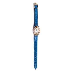 An 18K gold Ladies quartz wristwatch, by   ...