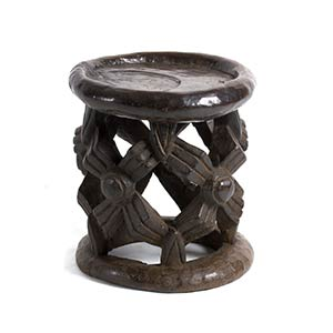 A BAMILEKE WOODEN 'SPIDER' STOOL FROM ...