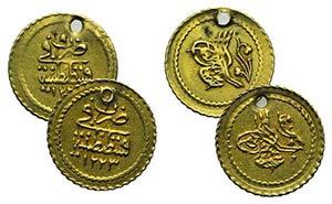 Lot of 2 AV Islamic coins (pierced), to be ...