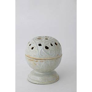 A QINGBAI-GLAZED PIERCED AND MOULDED INCENSE ...