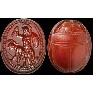 A precious etruscan scarab in deep red ...