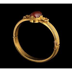An etruscan carnelian scarab, mounted in a ...