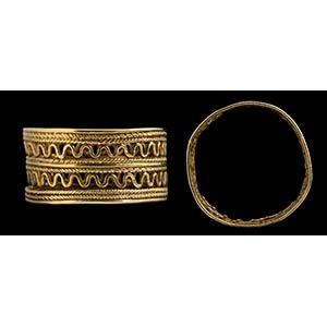 An etruscan gold ring. The hoop has a large ...