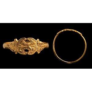 A greek gold ring. Two cranes. The engraved ...