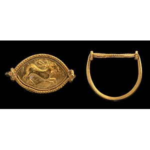 An etruscan gold ring. Horse. Bezel in the ...