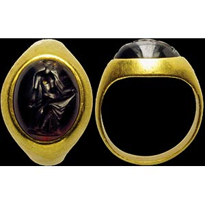 A hellenistic garnet intaglio, mounted on an ...