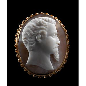 Large shell cameo mounted in a gold brooch. ...