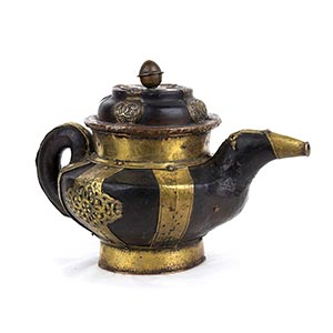 A PARTIALLY GILT COPPER AND BRASS TEAPOT AND ...