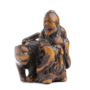 A WOOD NETSUKE OF BUNKAN WITH THE TIGERearly ...