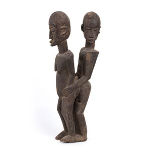 A WOOD SCULPTURE OF A MALE AND FEMALE ...
